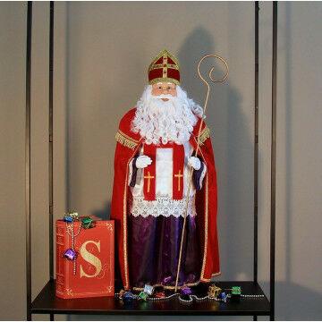 Sinterklaas met boek en pakjes